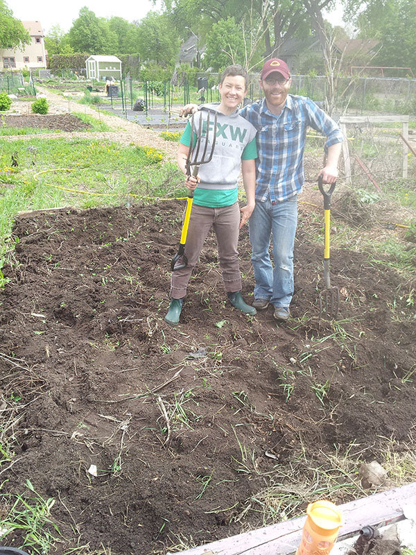 Digging up a neglected community garden plot in Minneapolis