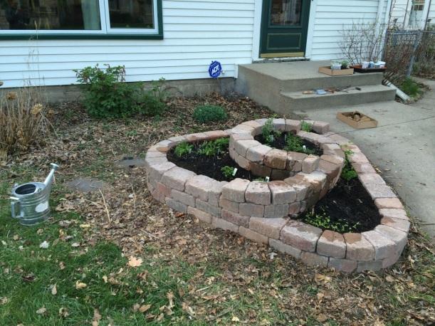 Hugelkultur herb spiral