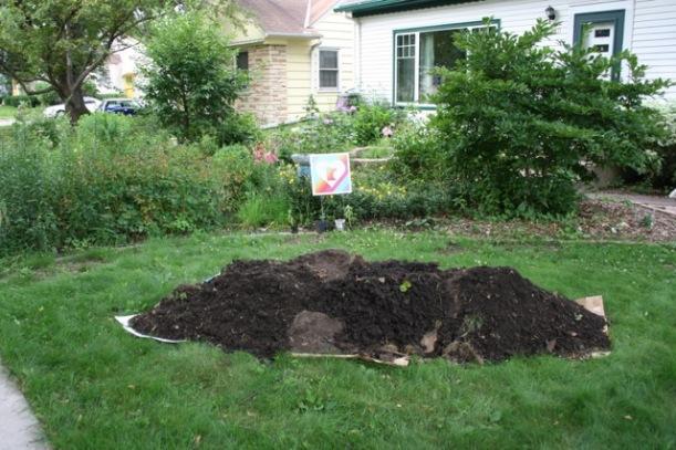 A huge pile of soil, via The New Home Economics